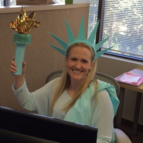 Emily proudly carries the torch to remind us that SmartVault is 100% made in the USA.